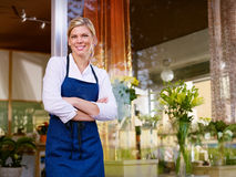 Young Woman Working As Florist In Shop Royalty Free Stock Photos