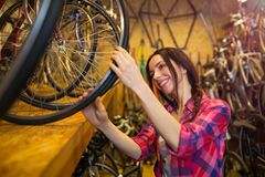 Young woman working in a bicycle repair shop Stock Photos