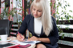 Young woman working with business papers Royalty Free Stock Photo