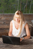Young woman working in cabin Royalty Free Stock Images