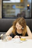Young woman working in a cafe Royalty Free Stock Photography