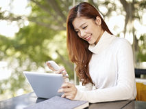 Young woman working in coffee shop Stock Photos