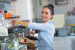 Barista making coffee Royalty Free Stock Image