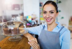 Woman working in coffee shop Royalty Free Stock Photography