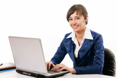 Young woman working with compute. R at the desk Royalty Free Stock Photo