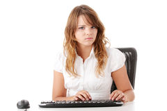 Young woman working on computer Royalty Free Stock Photos