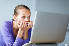 Young woman working on a computer at an office Stock Images