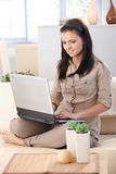Young woman working on computer smiling Stock Images