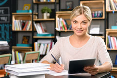 Young woman is working at the desk Stock Image