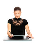 Young woman working on a digital tablet Royalty Free Stock Photos