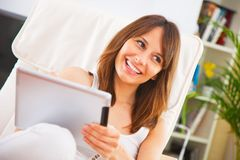 Young woman working with a digital tablet on the room Royalty Free Stock Photos