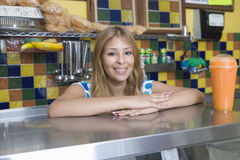 Young Woman Working In Diner. Portrait of a pretty young women working in diner Stock Photo