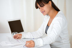 Young woman working with documents at office Stock Photo