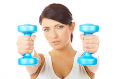 Young woman working with dumb-bells. Portrait of fit young woman working with dumb-bells, isolated on white Stock Photos