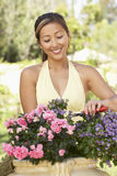 Young Woman Working In Garden Royalty Free Stock Photos