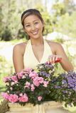Young Woman Working In Garden Royalty Free Stock Images