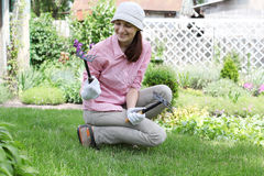 Young woman  working in the garden bed Stock Photo