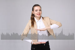 Young woman working with graph chart. Future technologies for busines, stock market concept Royalty Free Stock Image