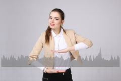 Young woman working with graph chart. Future technologies for busines, stock market concept Royalty Free Stock Photo