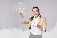 Young woman working with graph chart. Future technologies for busines, stock market concept Royalty Free Stock Photography