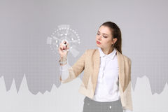 Young woman working with graph chart. Future technologies for busines, stock market concept. Stock Image