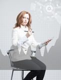 Young woman working with graph chart. Future technologies for busines, stock market concept. Royalty Free Stock Image