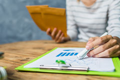 Young woman working hard work at home house tax calculating. Royalty Free Stock Photography