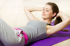 Young Woman Working On Her Abs Royalty Free Stock Image