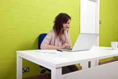 Young woman working at her desk Stock Image
