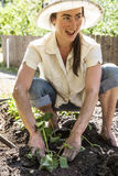 Young woman working her home garden. Stock Photo