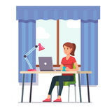 Young woman working at her home office desk Royalty Free Stock Images