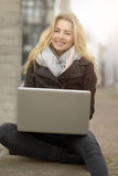 Young woman working on her laptop Stock Photography