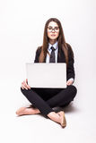 Young woman working on her laptop, sitting on the floor stock photos