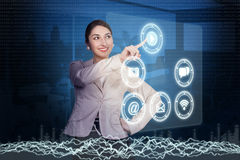 Young woman working with high-tech Royalty Free Stock Image