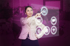 Young woman working with high-tech. Beautiful young woman working with high-tech Stock Image