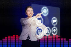 Young woman working with high-tech. Beautiful young woman working with high-tech Stock Photos