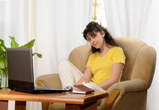 Young woman working at home Stock Image