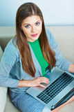 Young woman working at home. Computer, laptop. Royalty Free Stock Image