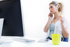 Young woman working from home on the computer and talking on the Stock Image