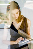 Young woman working home on her tablet Royalty Free Stock Image