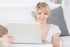 Young woman working at home on a laptop Stock Images