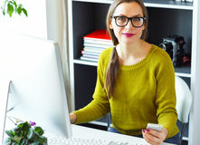 Young woman working from home - modern business concept Stock Images