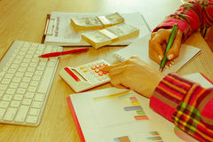 Young woman working in home, sitting at desk, using computer. Business grant and finances concept. Business woman working at the office - Retro color stock photography
