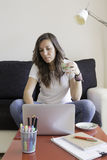 Young woman working at home Stock Images