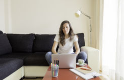 Young woman is working at home Stock Images