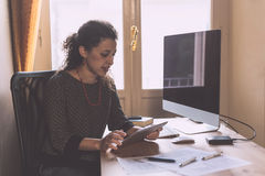 Young Woman Working at Home Stock Photography