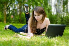 Young woman working on laptop. Stock Photos