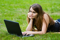 Young woman working on laptop. Royalty Free Stock Photography