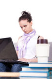 Young woman working on laptop. On white background Royalty Free Stock Photography