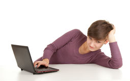 Young woman working on laptop. White background Stock Images
